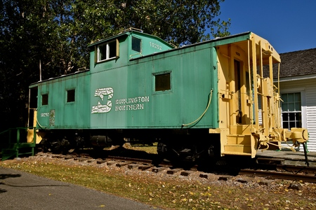 PEKIN, NORTH DAKOTA, September 1, 29018: The old  green caboose was once property of Burlington Northern which has since become BNSF, part of Berkshire Hathaway subsidiary.