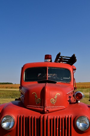 PEKIN, NORTH DAKOTA, September 2, 2018: An old restored classic red Ford Fire truck is displayed at the Stump Lake Threshing Bee during the Labor Day festivities.