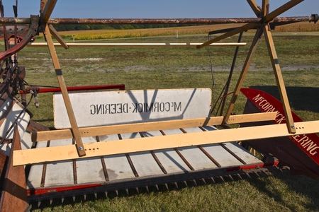 PEKIN, NORTH DAKOTA, September 2, 2018: An old restored classic McCormick Deering grain swather is displayed during the Labor Day Stump Lake Village Threshing Bee.