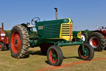 PEKIN, NORTH DAKOTA, September 2, 2018: An old restored classic Oliver Row Crop 88 tractor is displayed during the  Stump Lake Village Threshing Bee annually held Labor Day weekend.