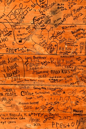ROLLAG, MINNESOTA, September 1, 2018: Attendess leave signatures, dates, and comments on a wall at the annual WCSTR farm threshers reunion in Rollag held each labor Day weekend where thousands attend. Stock fotó - 115361032