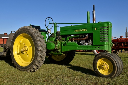 ROLLAG, MINNESOTA, September 1, 2018: A restored John Deere A tractor is displayed at the annual WCSTR farm threshers reunion in Rollag held each labor Day weekend where thousands attend.
