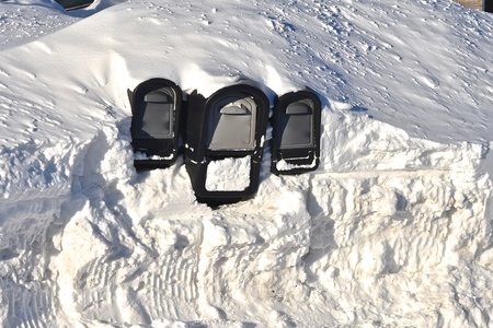 A Mailbox nearly  buried in a snowdrift required digging to receive the daily mail after a snowstorm.
