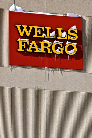 FARGO, NORTH DAKOTA, February 7, 2019: The drive-up bank with snow drifts is a location of the Wells Fargo Co. founded 1700 years ago by Henry Wells and William G. Fargo