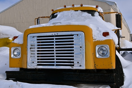 MOORHEAD, MINNESOTA, February 13, 2019: The snow covered truck covered with snow is a product of the International Harvester Company which was a United States manufacturer of agricultural machinery, construction equipment, and trucks.