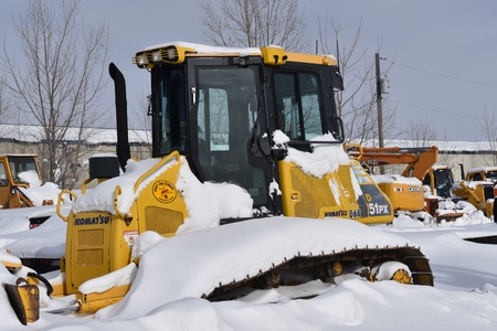 MOORHEAD, MINNESOTA February 13, 2019: The 51PX snow covered bulldozer  is a product of Komatsu a Tokyo, Japan based company that manufactures construction, mining, and military equipment, founded in 1921company that manufactures construction.