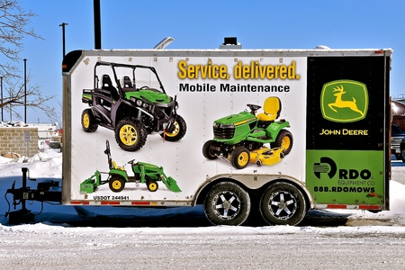 MOORHEAD, MINNESOTA, February 14, 2019: The double axle 4 wheeled trailed is used to haul products of John Deere Co, an American corporation that manufactures agricultural,