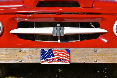 ROLLAG, MINNESOTA, September 2, 2018: An old International (IH) truck grill with God Bless America plates is displayed at the annual WCSTR farm threshers reunion in Rollag held each labor Day weekend where thousands attend.