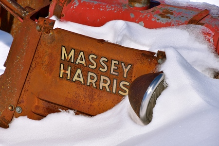 BARNESVILLE, MINNESOTA, March 11, 2019: The logo and tractor is a Massey Harris  which eventually became Massey Fergusonwhen a merger of Massey Harris and the Ferguson Company farm machinery manufacturer occurred in 1953