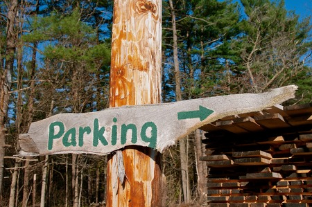 A slab of wood  converted into a sign indicates the