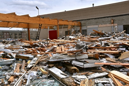 Brick, metal, and debris are left on the ground after a demolition project. Stock Photo