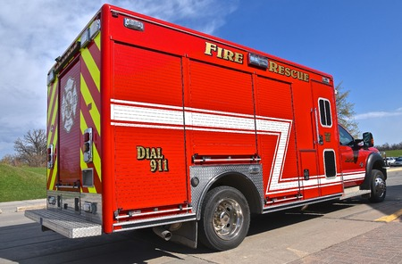 A red fire and rescue vehicle is ready for immediate service