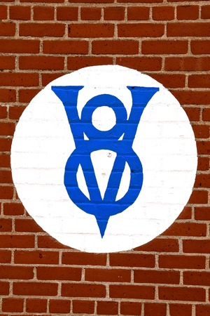 HILLSBORO, NORTH DAKOTA, May 10, 2019:  The Ford V* engine logo sign painted on a brick wall represents products of the Ford Motor Company located in Dearborn, Michigan started by Henry Ford and incorporated on June 16, 1903.