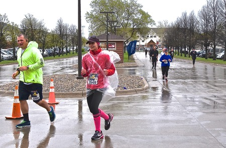 FARGO, NORTH DAKOTA-May 136 2019 : Marathoners run in inclement weather at the annual Sanford Fargo Marathon which includes a cyclothon, dog race, youth, 5K, 10K, half, and full runs.