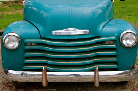 ROWLEY, MASSACHUSETTS, April 28, 2019: The old restored pickup from the 40`s or 50`s, is a Chevrolets, colloquially referred to as Chevy and formally the Chevrolet Division of General Motors Company, an American auto division of the American manufacturing