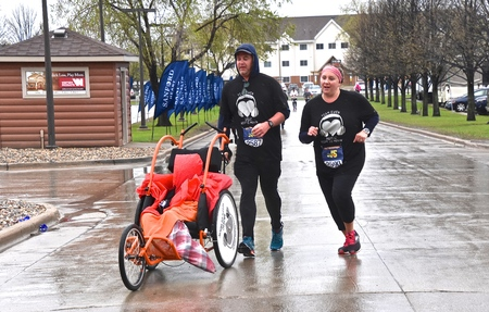 FARGO, NORTH DAKOTA-May 16, 2019 : Marathoners run in inclement weather at the annual Sanford Fargo Marathon which includes a cyclothon, dog race, youth, 5K, 10K, half, and full runs. Editorial