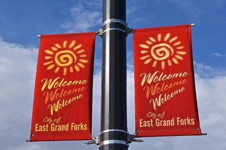 EAST GRAND FORKS, MINNESOTA, May 10, 2018:  The red flags welcome people to EGF, a city in Polk County, Minnesota, with a population of 8,601 at the 2010 Census.