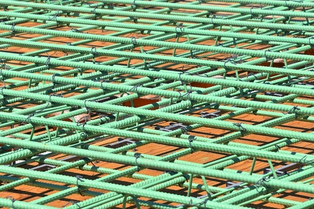 Layers of rebar in the construction of a bridge over a four lane highway which is ready for concrete