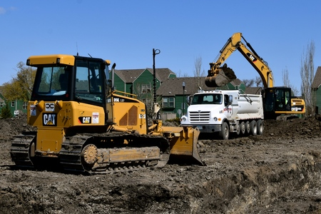 MOORHEAD, MINNESOTA, May 9, 2019: 2019: The Cat DK5 bulldozer scraping dirt at a construction site is a product from Caterpillar Inc., an American corporation founded in 1925 which designs, develops, engineers, manufactures, markets and sells machinery, Editöryel