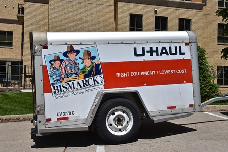 EDINA, MINNESOTA, May 25, 2019:  The trailer advertising Bismarck is a product of U-Haul an American moving equipment and storage rental company, based in Phoenix, Arizona in operation since 1945. Editöryel