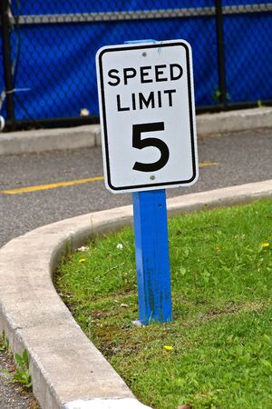 The driving speed limit around a race track curve is 5 mph.