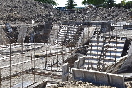 Forms are being set at basement level needed to create a foundation for a new house.