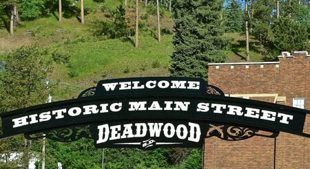 A sign hangs in from of  historic Main street  Deadwood, South Dakota welcoming tourists