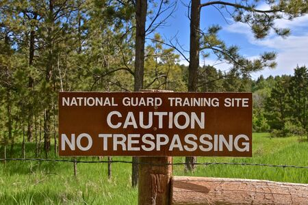 A wooden sign indicates a National Guard training site