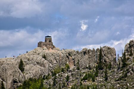 The distant mountain is Black Elk Peak, formerly known as Harney Peak,  of the Black Hills in South Dakota.