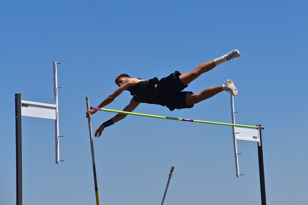 FARGO, NORTH DAKOTA, July 5, 2019: A young  man participates in the pole vault at the Regional  United States Association of Track andField) USATF track meet.