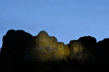 Lights brighten up the Mount Rushmore monument on a perfectly clear evening at dusk.