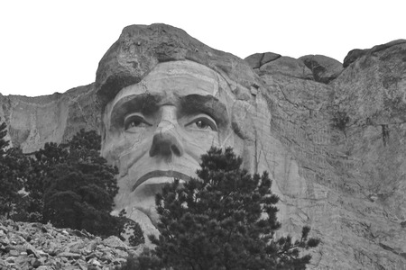 Mount Rushmore National Memorial near Keystone South Dakota, Looking up at a carved likeness of Abraham Lincoln at dusk. (black and white) Redakční