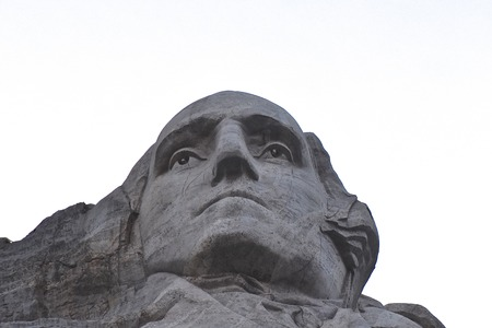 Mount Rushmore National Memorial near Keystone South Dakota, Looking up at a carved likeness of George Washington at dusk. (black and white) Redakční