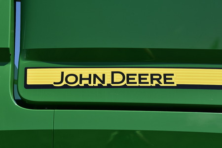 MOORHEAD, MINNESOTA, July 1019, 2017: The new JOHN DEERE words identify machinery for the John Deere Co, an American corporation that manufactures agricultural, construction, fore Redakční
