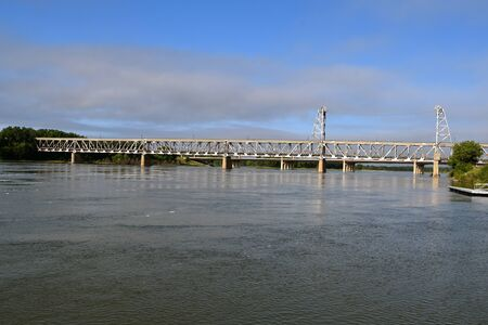 A swollen Missouri River flows under the retired two tiered bridge which connects Nebraska and South Dakota by the city of Yankton.