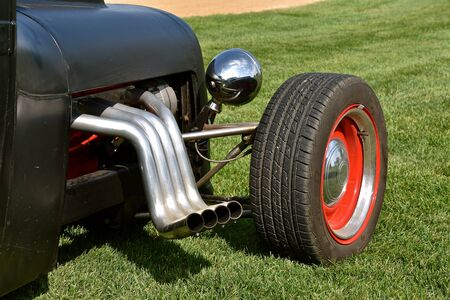 A street rod has conversion includes each cylinder with a custom pipe attached to the manifold.