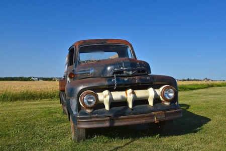 MOORHEAD, MINNESOTA, August 7, 2019:  The Old Ford V8 pickup with a unique white grill is a product of the Ford Motor Company located in Dearborn, Michigan started by Henry Ford and incorporated on June 16, 1903.