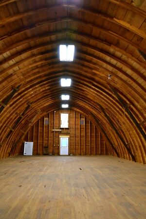The hayloft of an old barn is modernized with a series of new sky lights.