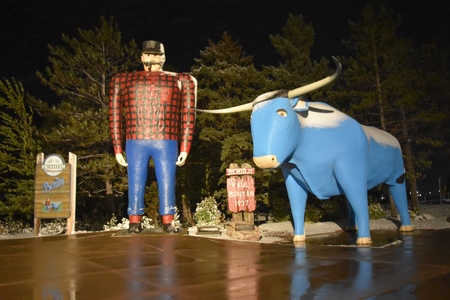 BEMIDJI, MINNESOTA, October 11,  2019: The legendary Paul Bunyan and Babe statute are a tourist attraction run by the parks system of Bemidji, Minnesota.