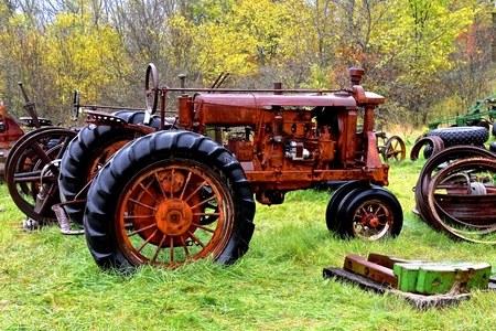 VERGAS, MINNESOTA, Oct 5, 2019:  The Farmall F-12 tractor left in a rain soaked junkyard was a model name and later a brand name for tractors manufactured by the American company International Harvester (IH).