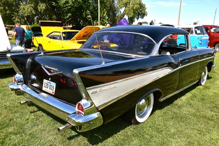 YANKTON, SOUTH DAKOTA, August 17, 2019: The restored black 1957 Chevy is displayed at the annual Riverboat Days Auto Show celebrated the third weekend of August in Yankton.