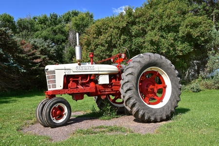 MADISON, SOUTH DAKOTA, August 18, 2019: A The freshly painted unique Farmall H tractor with a flat tire is a brand manufactured by the American company International Harvester. Co. IH
