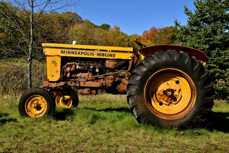 VERGAS,  MINNESOTA, October 6, 2019:   2015: Parked near a woods is the M5 Minneapolis Machine tractor. The company was based in Minnesota and was the product of a merger between three companies in 1929: Minneapolis Steel & Machinery (MSM), Minneapolis Th