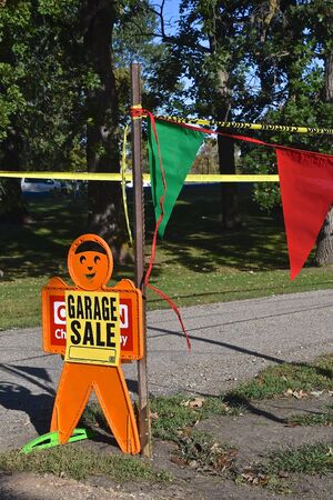 A gingerbread man advertises the location of a garage sale.