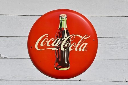ROCHFORD, SOUTH DAKOTA, June 27, 2019: The old Coca Cola bottle sign advertises the soft drink invented by John Pemberton in the late 1800`s is headquartered in Atlanta, GA.