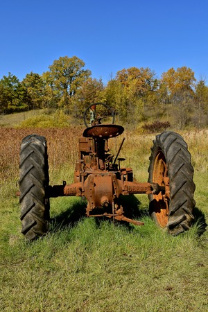 VERGAS, MINNESOTA, October 6, 2019: The old John Deere tractor is a  product of John Deere Co, an American corporation that manufactures agricultural and construction equipment, drive trains, and transmission.