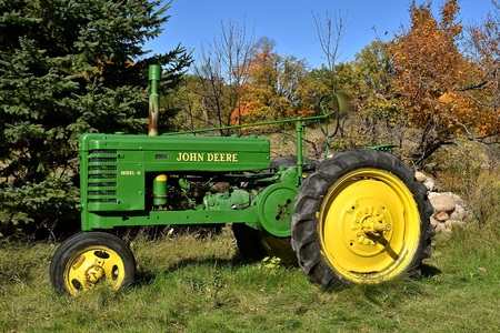 VERGAS, MINNESOTA, October 6, 2019: The old refurbished  Model H John Deere tractor is a  product of John Deere Co, an American corporation that manufactures agricultural and construction equipment, drive trains, and transmission.
