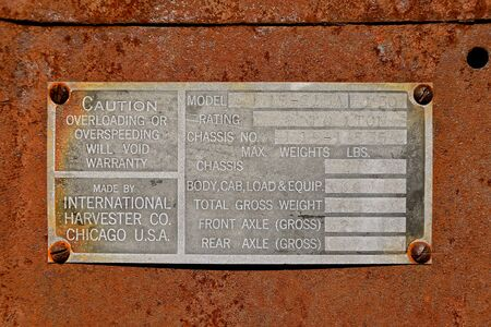 DOWNER, MINNESOTA October 6, 2019: The metal serial number tab of an  International pickup is a product of the International Harvester Company which was a United States manufacturer of agricultural machinery, construction equipment, and trucks.
