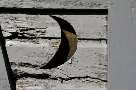 The crescent moon shape provided light and opening for fresh air in an outdoor bathroom. (outhouse)