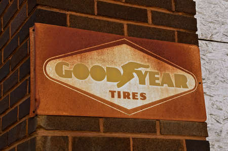 ISABEL, SOUTH DAKOTA, February 28, 2020: The old faded sign advertises The Goodyear Tire & Rubber Company, an American multinational tire manufacturing company in Akron, OH, founded in 1898 .